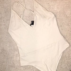 White bodysuit with crossing straps!